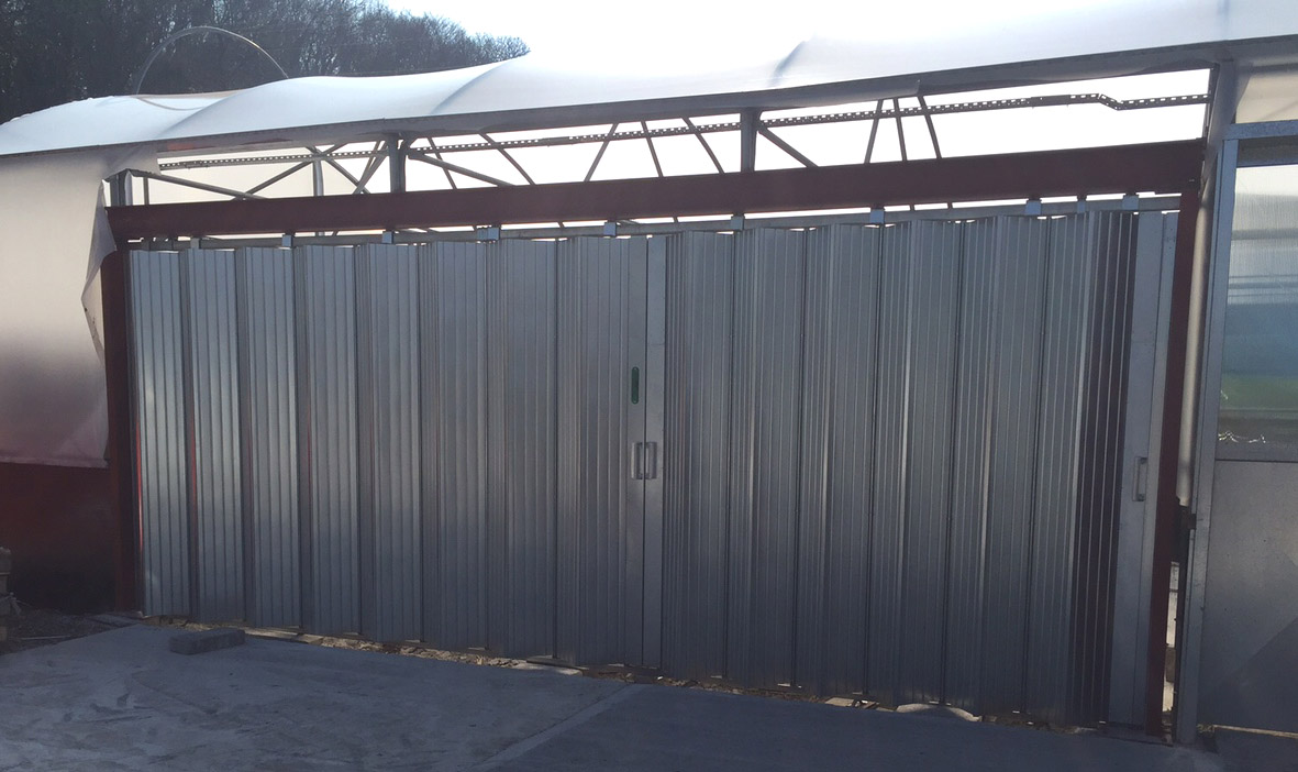 Sliding shutters fitted in a commercial polytunnel