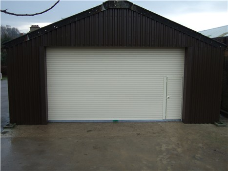 Door with wicket door and surrounding cladding
